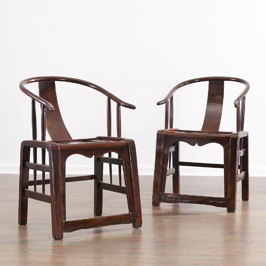 Pair Chinese hardwood horseshoe armchairs