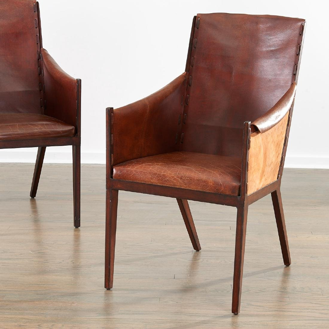 Pair Jean Michel Frank (after) leather chairs