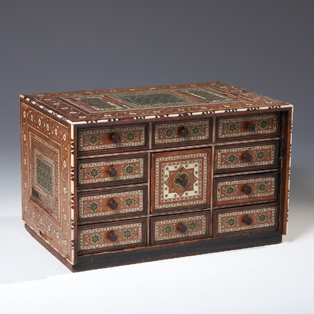 Damascus inlaid tabletop chest of drawers