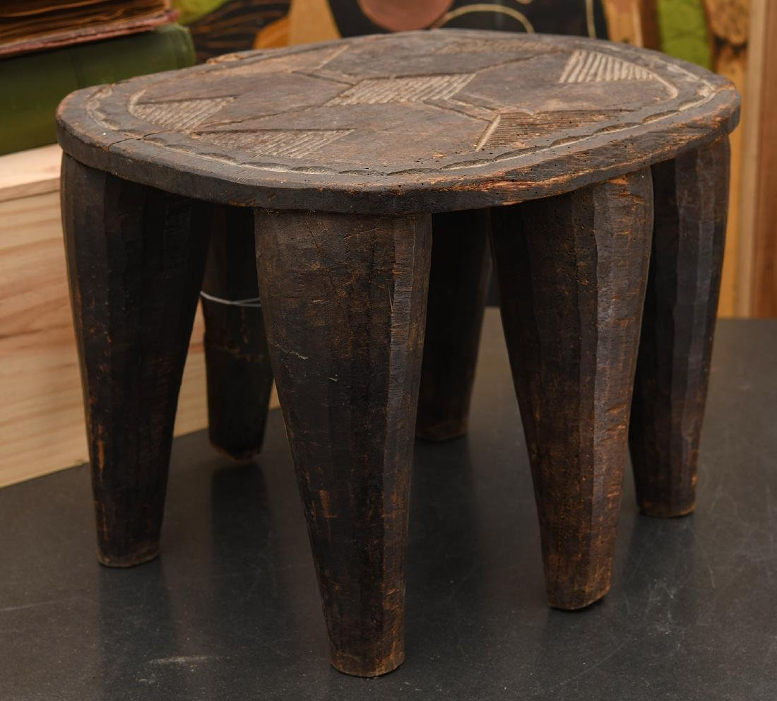 African carved six-legged stool