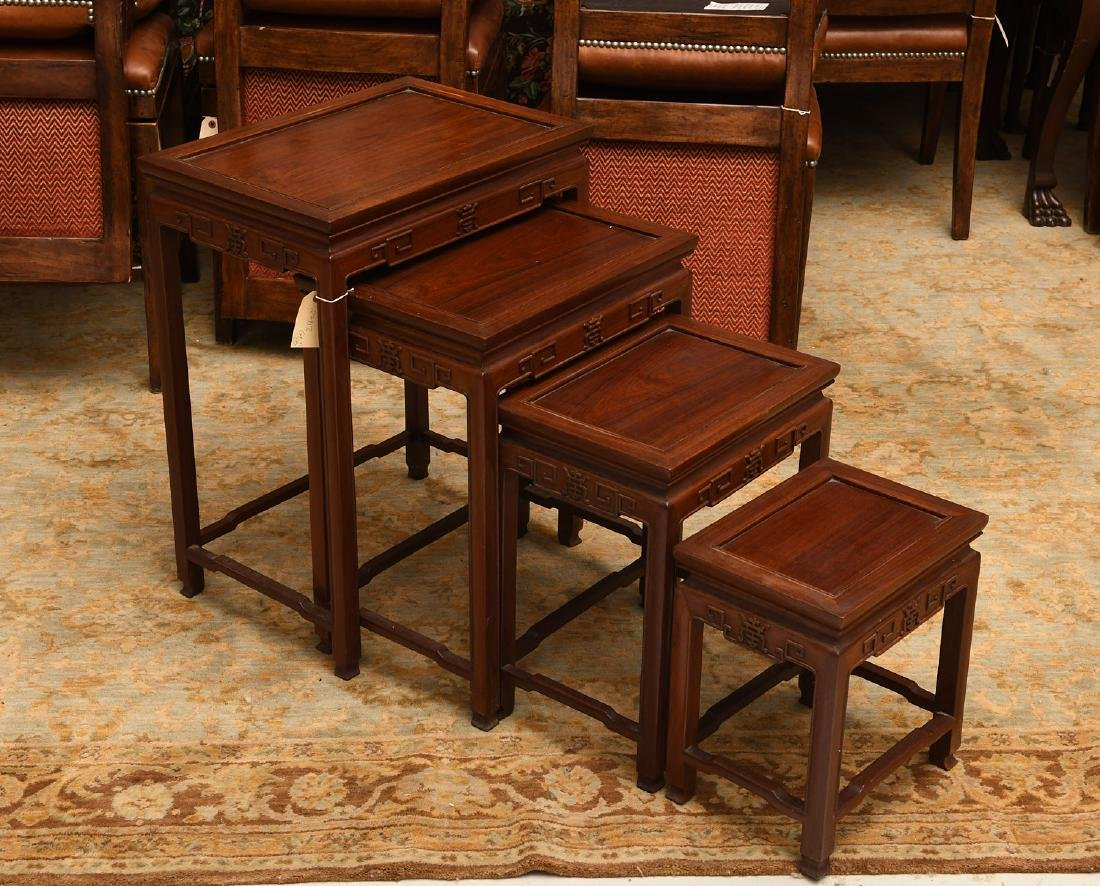 Set (4) Chinese carved hardwood nesting tables