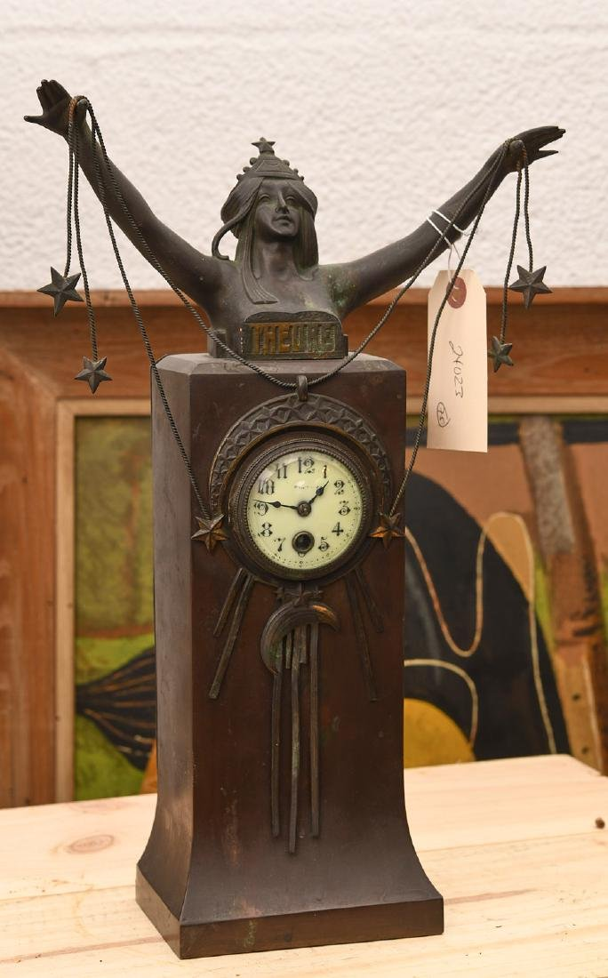 Art Nouveau patinated bronze figural clock