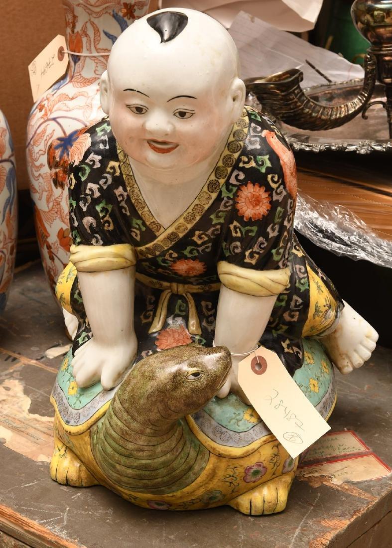 Chinese famille noir porcelain boy