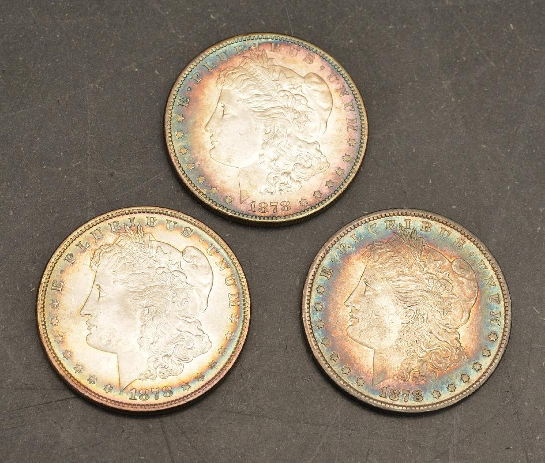 (3) 1878 Morgan silver dollars