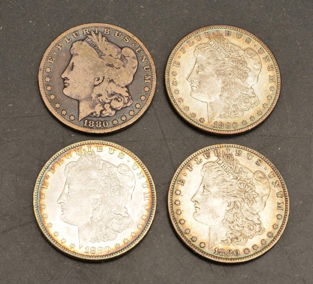 (4) 1880 Morgan silver dollars