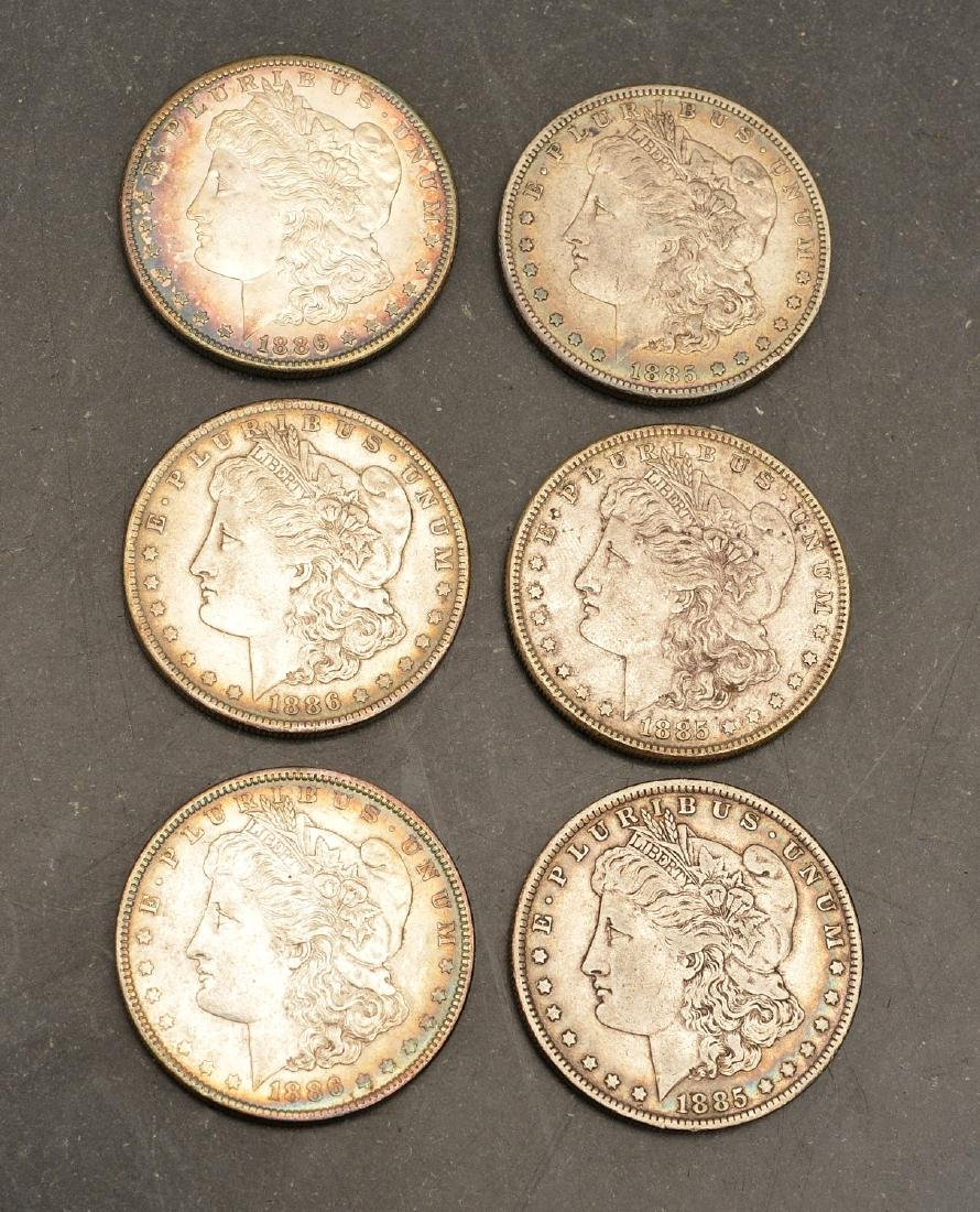 (6) 1885 & 1886 Morgan silver dollars