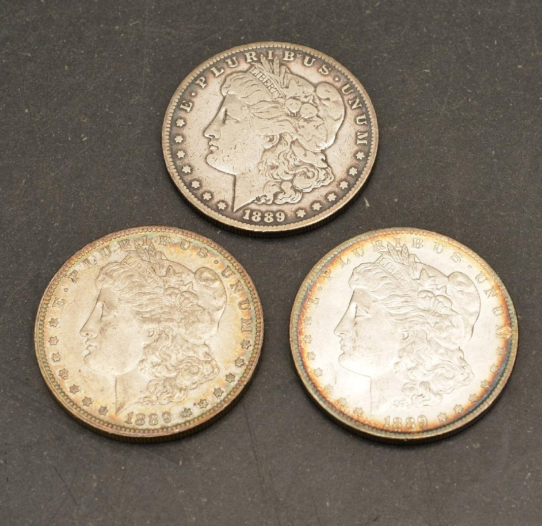 (3) 1889 Morgan silver dollars