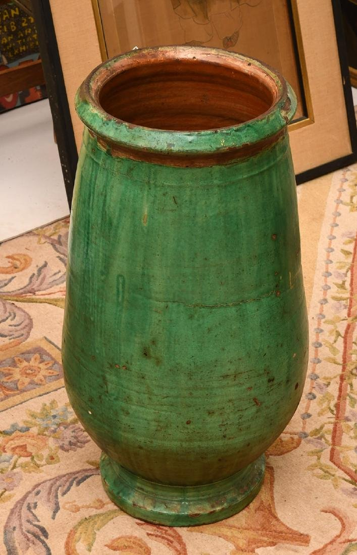 Large green glazed pottery storage jar