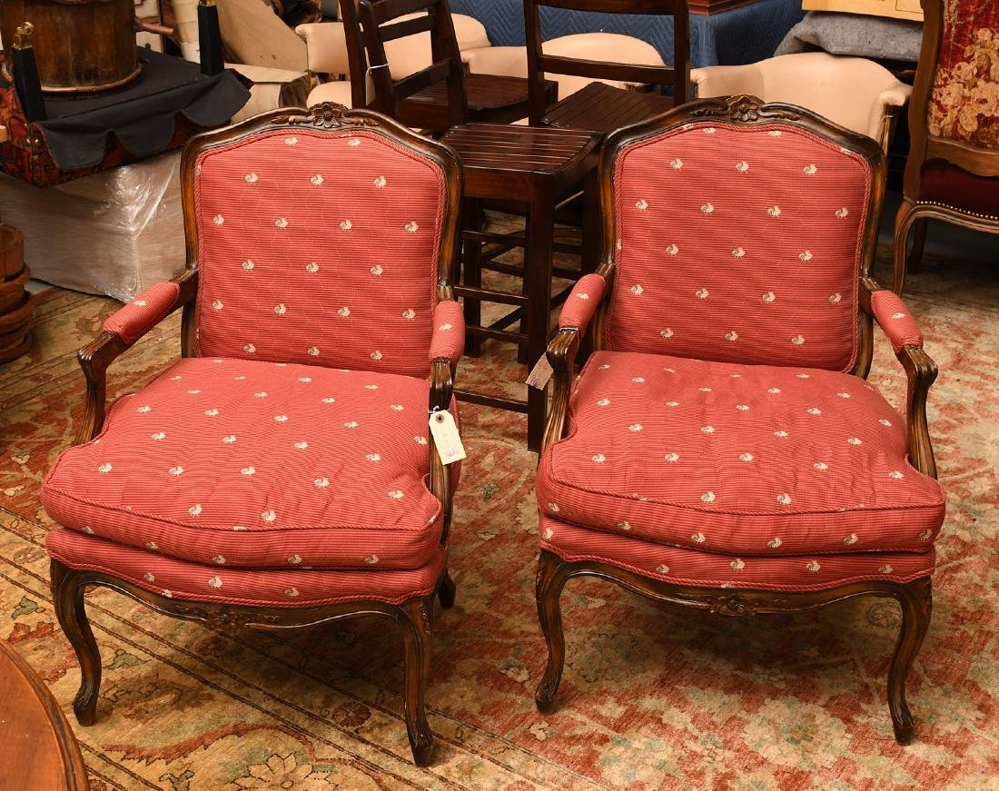 Pair Country French upholstered arm chairs