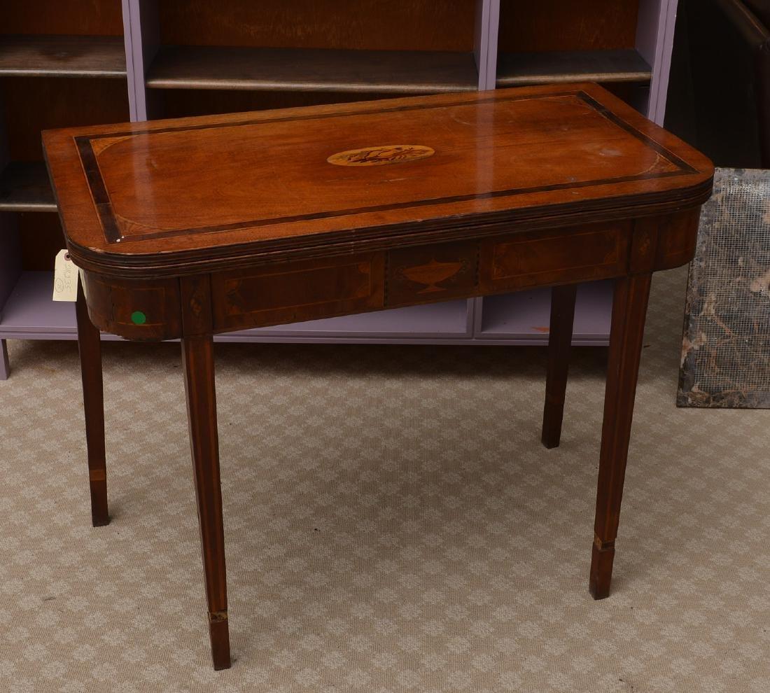 Antique mahogany inlaid games table