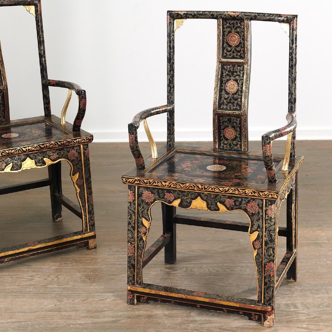 Pair Chinese gilt black lacquer yokeback armchairs