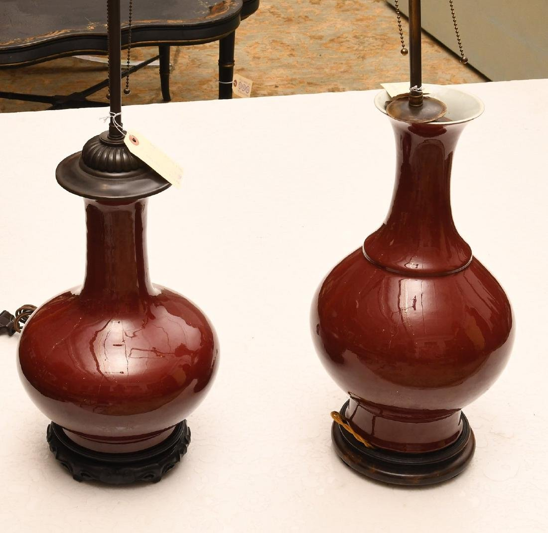 (2) Chinese porcelain oxblood vase lamps