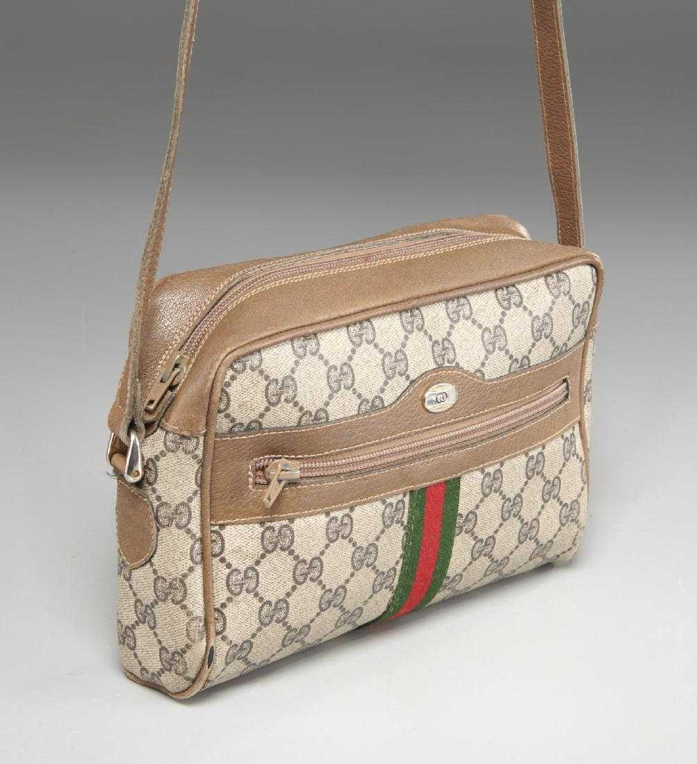 4a88a2ccd0a28a Gucci coated canvas monogram web handbag