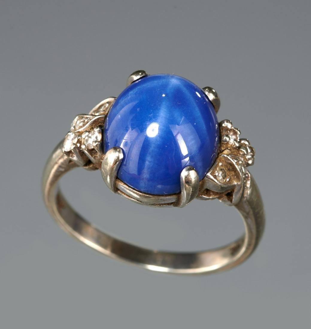 Blue star sapphire and diamond ring