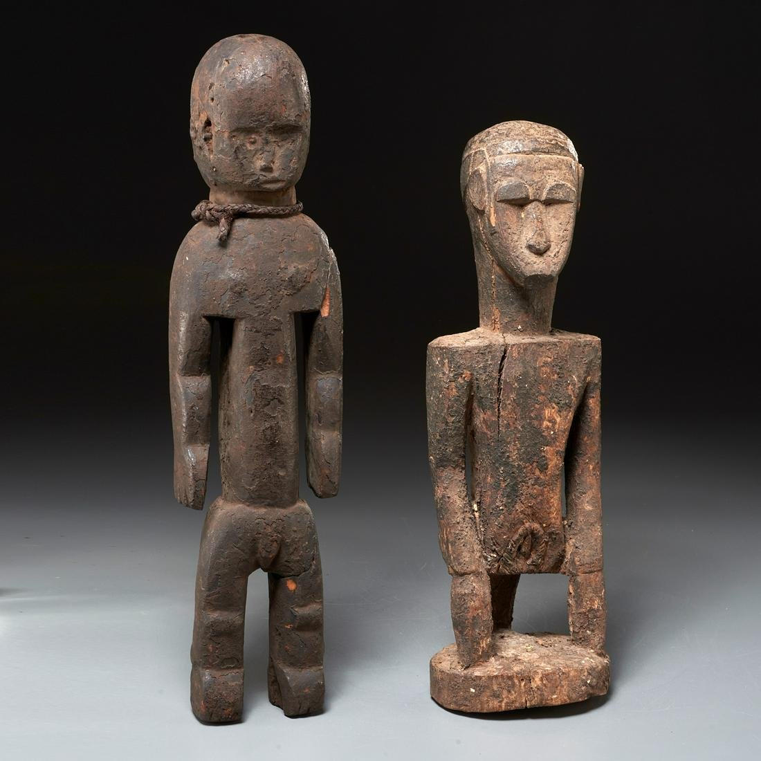 (2) Dogon carved standing figures, ex-museum