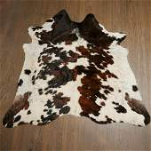 Cowhide throw rug