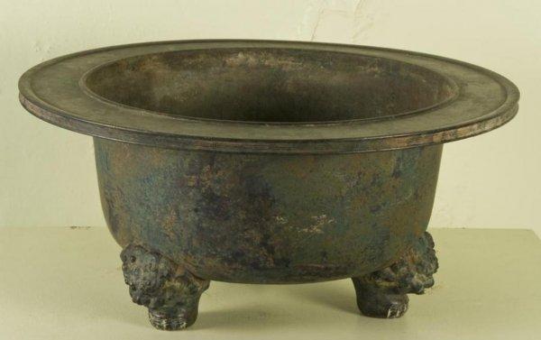 23: Antique Chinese patinated bronze tripod jardiniere