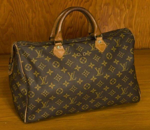 728: Louis Vuitton duffel handbag