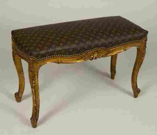 Louis XV style giltwood bench with Vuitton upholst