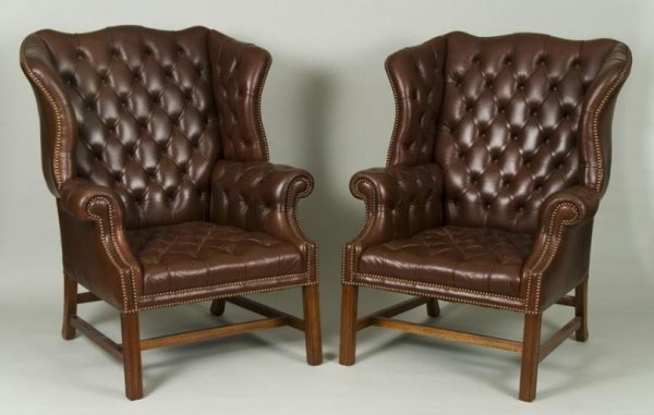 453: Pair George III style leather wing chairs by Smith