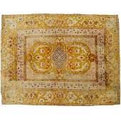 Antique room-size Agra carpet