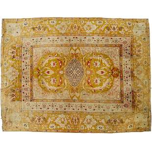 Antique room-size Agra carpet