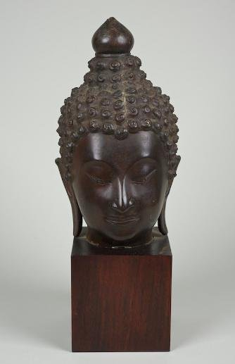 6: Large Southeast Asian bronze Buddha head fragment