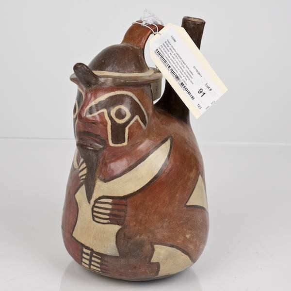 91: Nazca ceramic pan pipe player form bottle