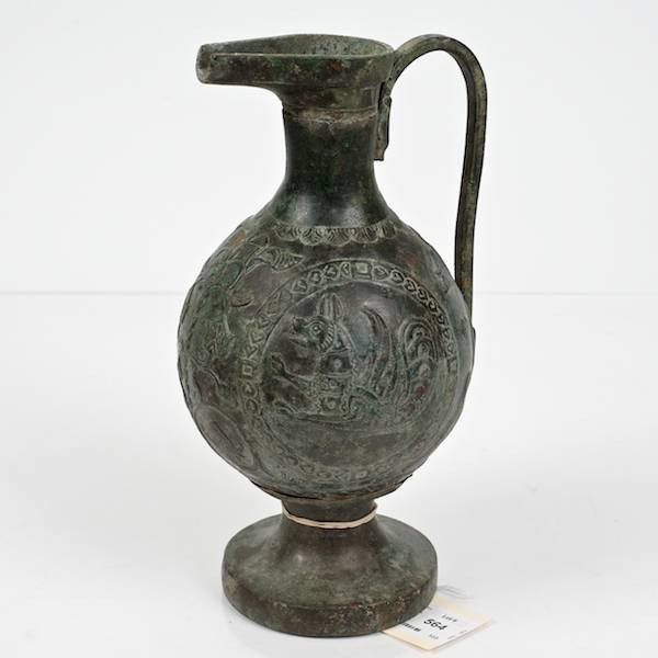 564: Ancient Near Eastern bronze ewer with chimera moti