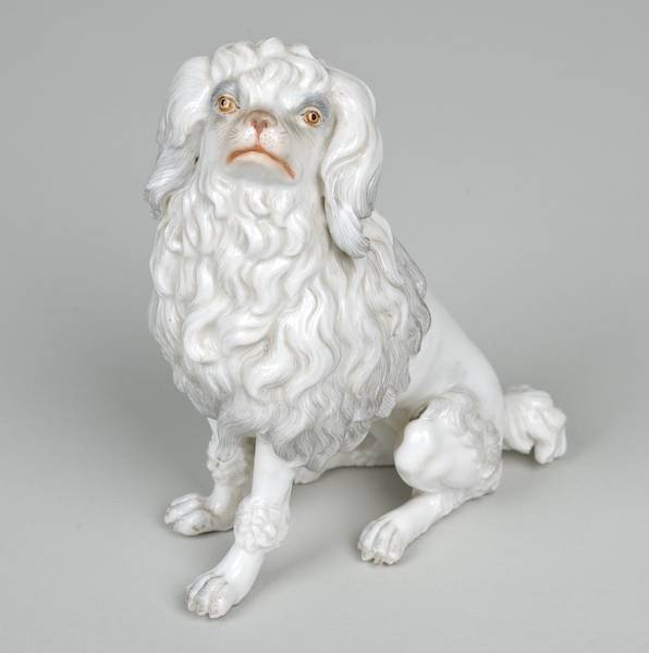 1006: Meissen model of a seated white Poodle