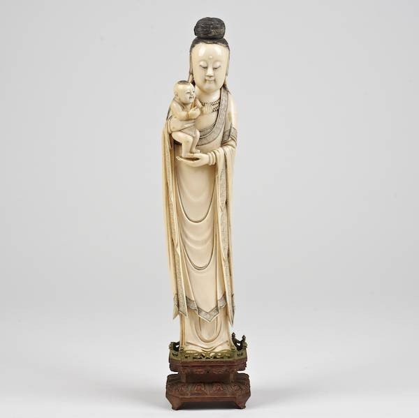 1415: Antique Chinese carved ivory Guanyin holding chil