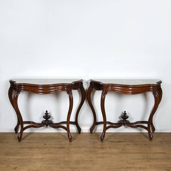 2087: Pair Rococo Revival carved walnut marble top cons