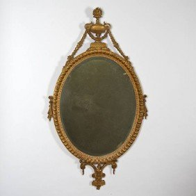 George III Giltwood Oval Mirror With Urn Crest