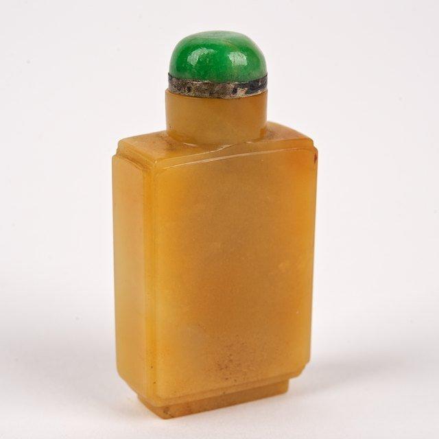 1033: Small Chinese yellow/orange jade snuff bottle