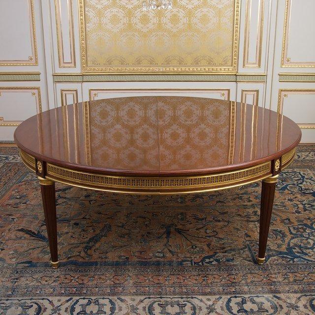 2013: Louis XVI style bronze mounted mahogany dining ta