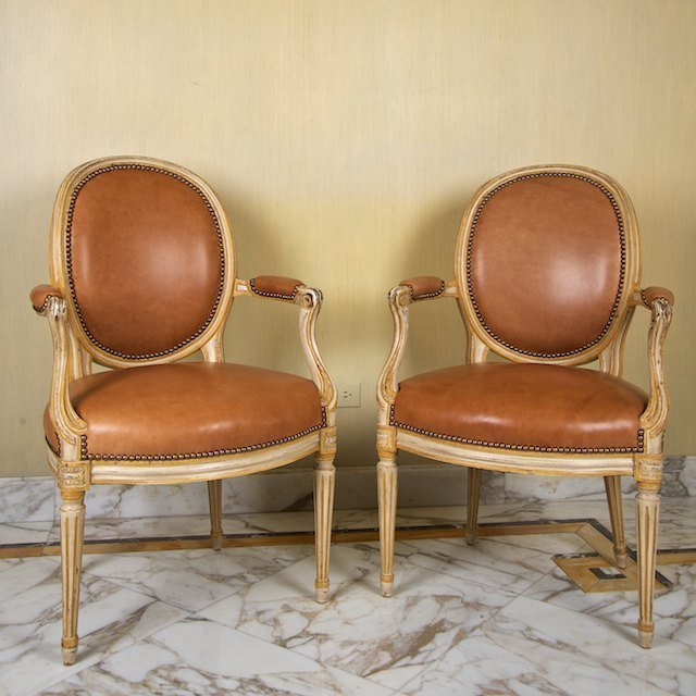 2022: Pair Louis XVI style cream painted leather fauteu