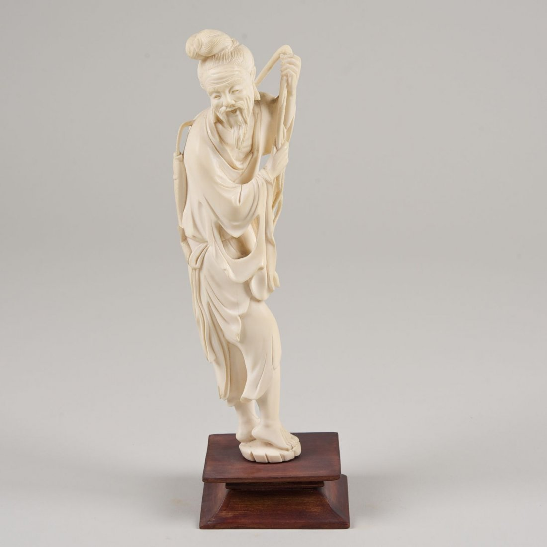 Chinese carved ivory figure of a fisherman
