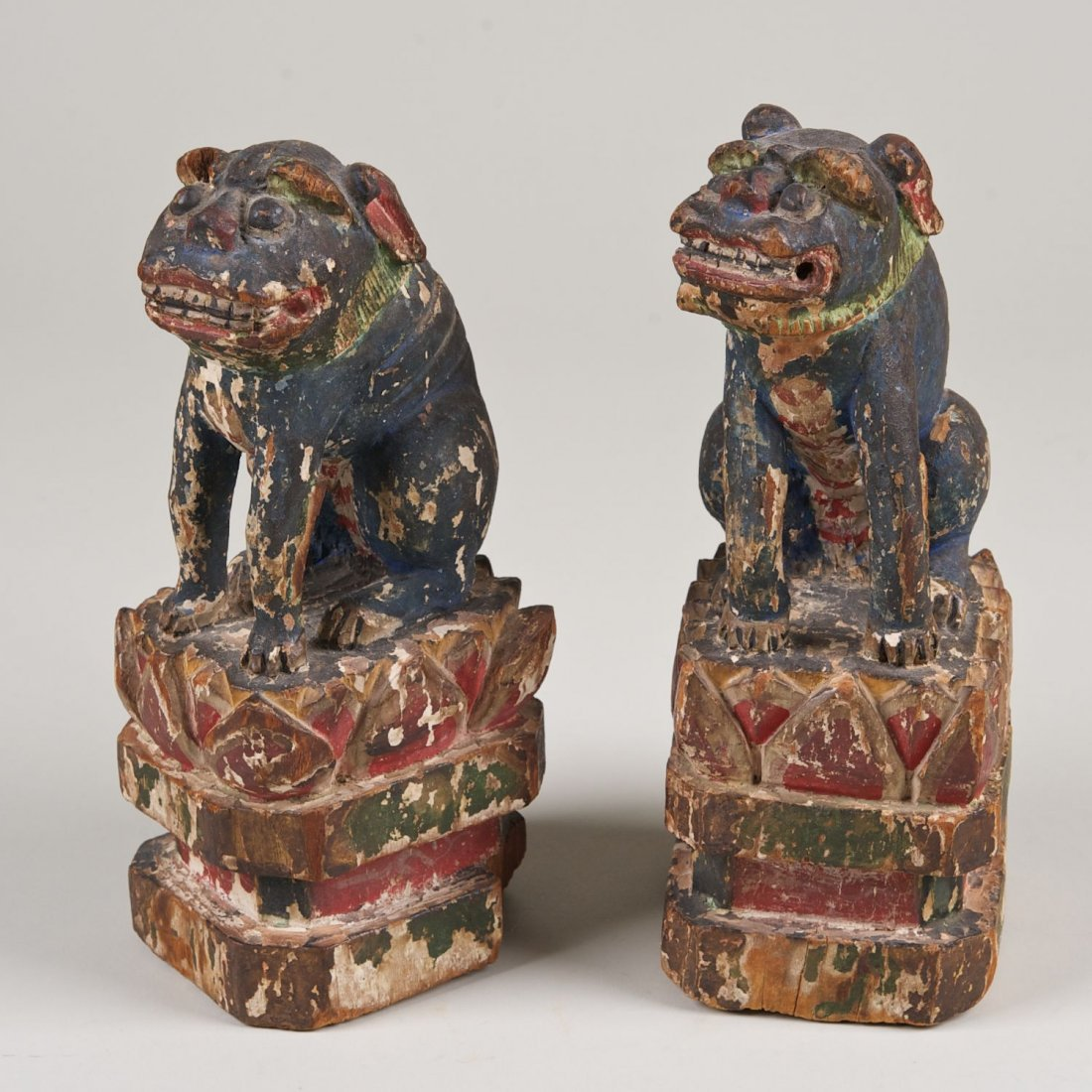 Pair Asian polychrome decorated Foo lions