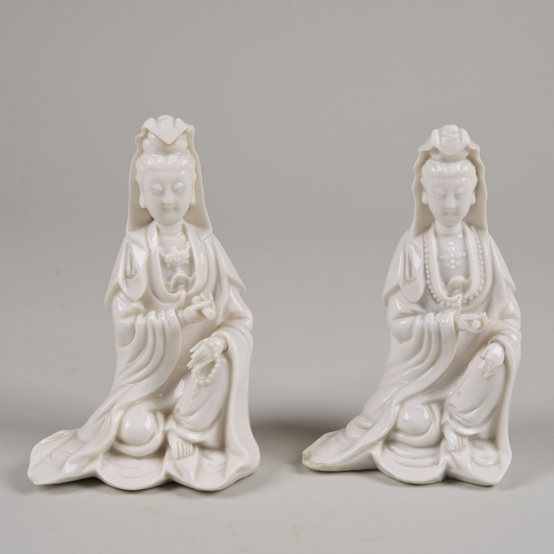 Pair Chinese blanc de chine seated guanyin figures