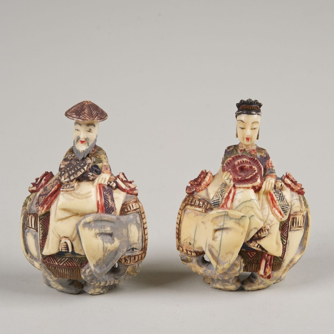 Pair Chinese carved and tinted ivory snuff bottles