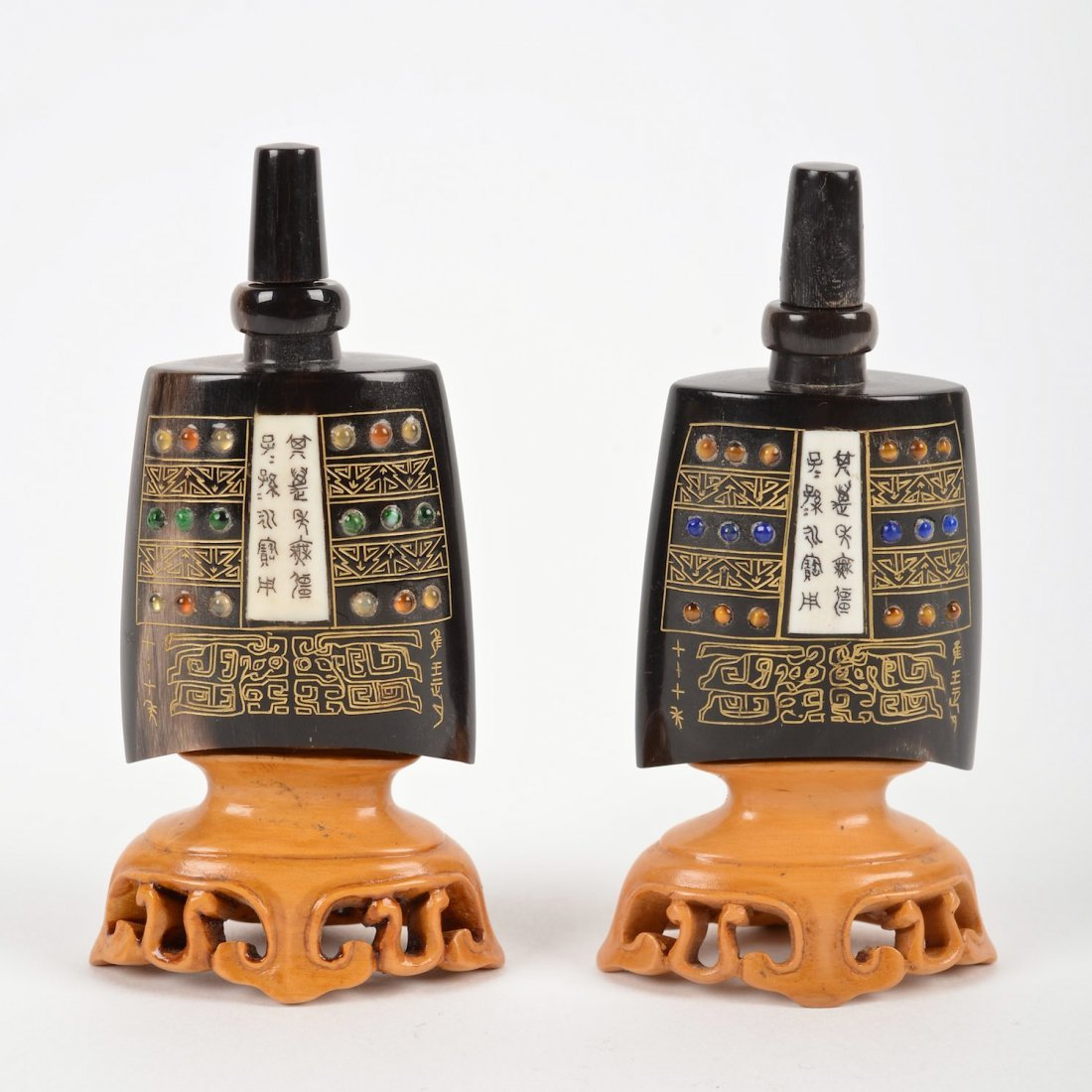 Pair carved horn temple bell form snuff bottles