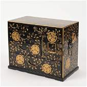 Japanese lacquered table top tansu cabinet