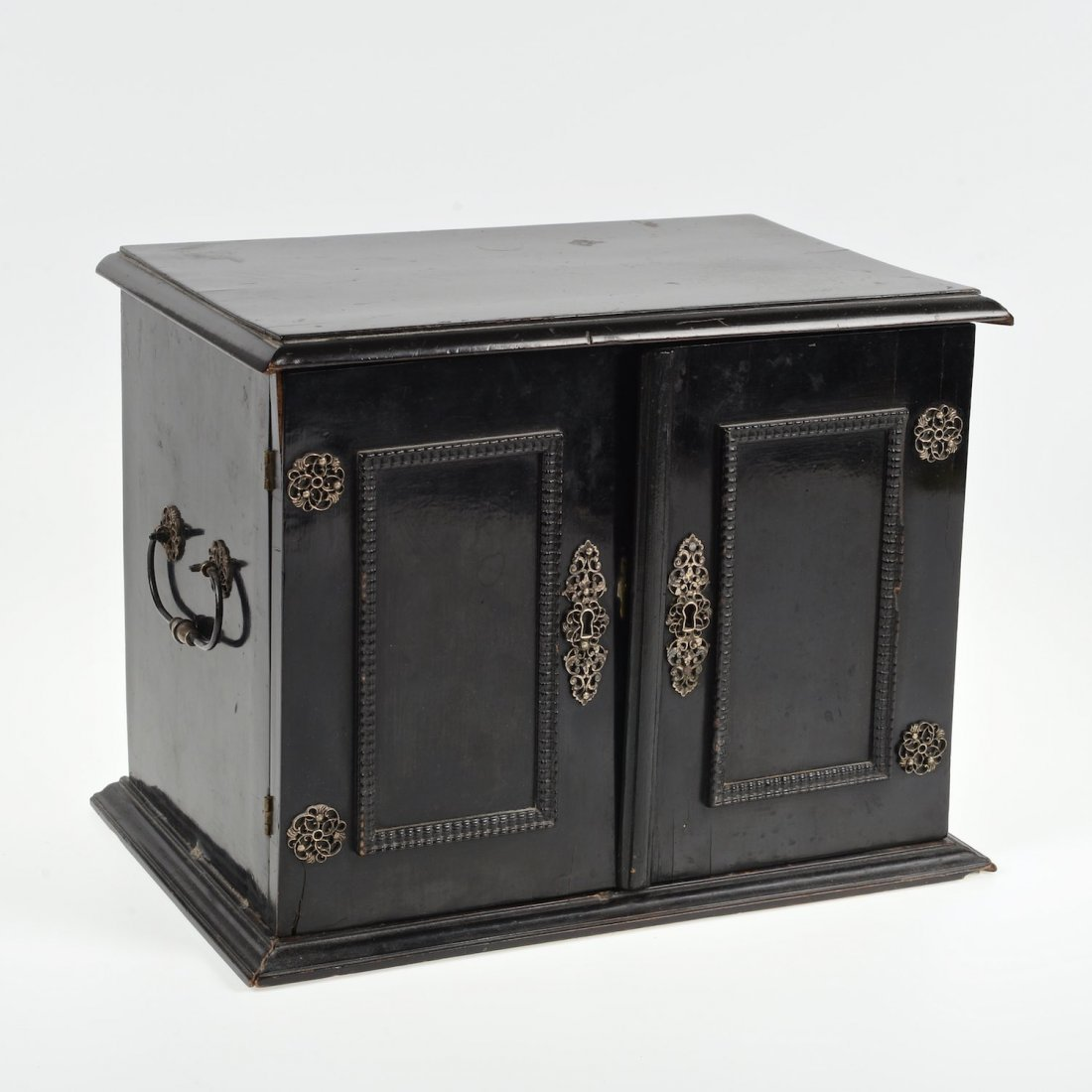 Dutch silver mounted ebonized wood table cabinet
