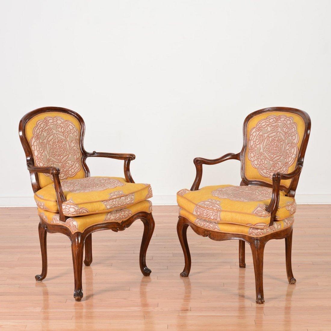 Near pair Italian Rococo carved walnut armchairs