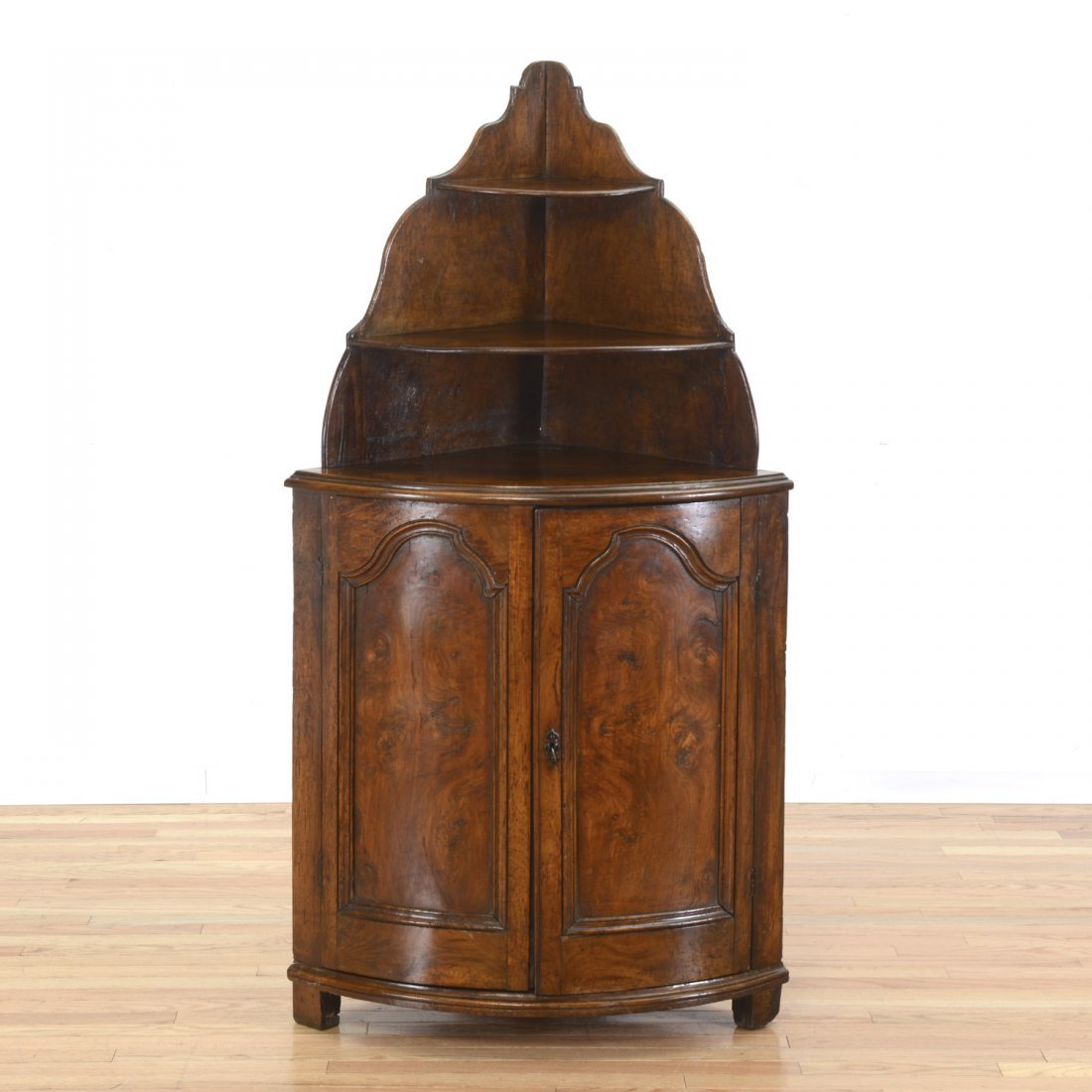 Continental figured walnut corner cabinet