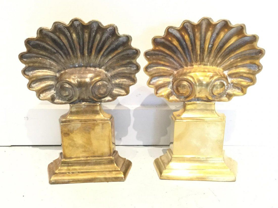Pair brass shell-form andirons/firedogs