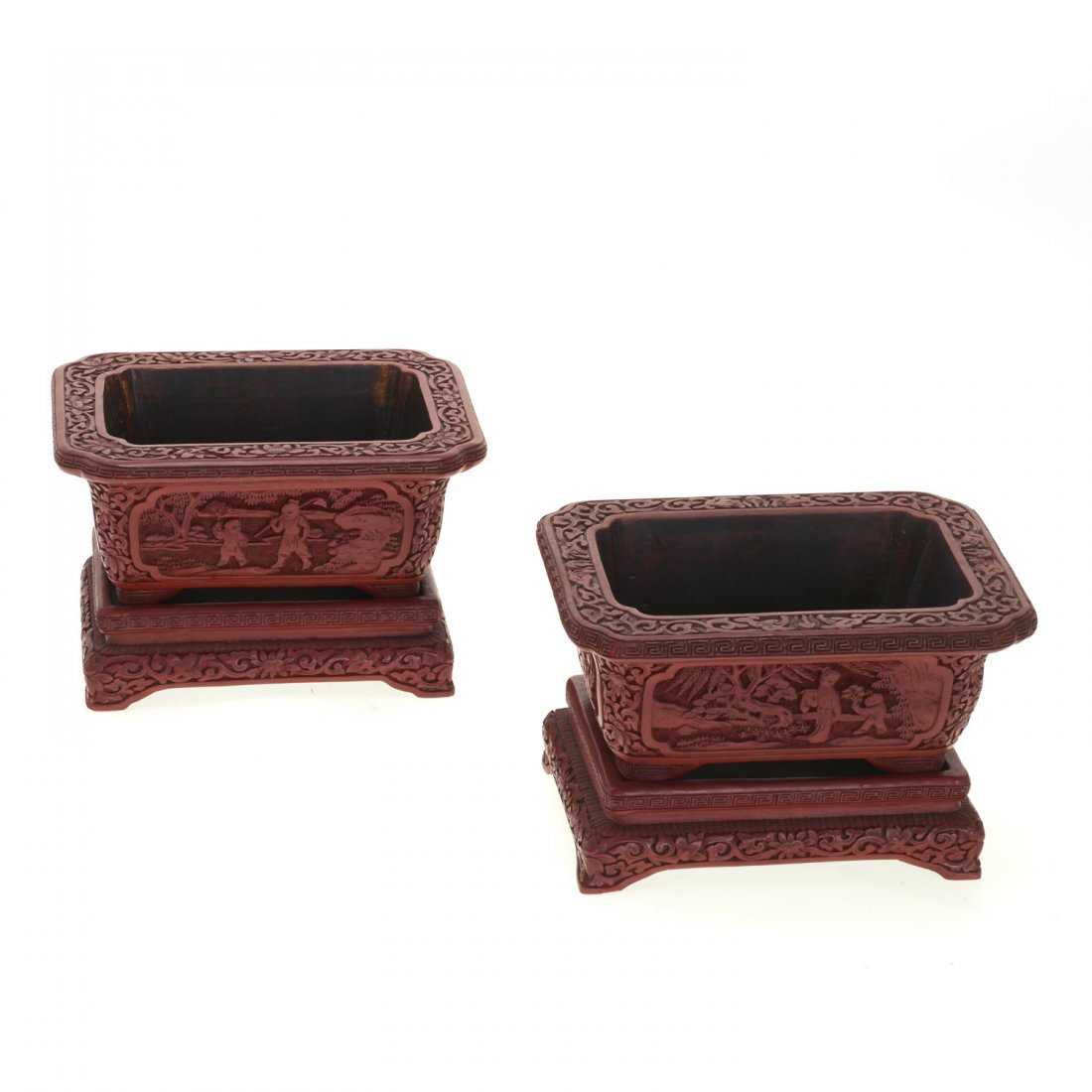 Pair Chinese red cinnabar jardinieres on stands
