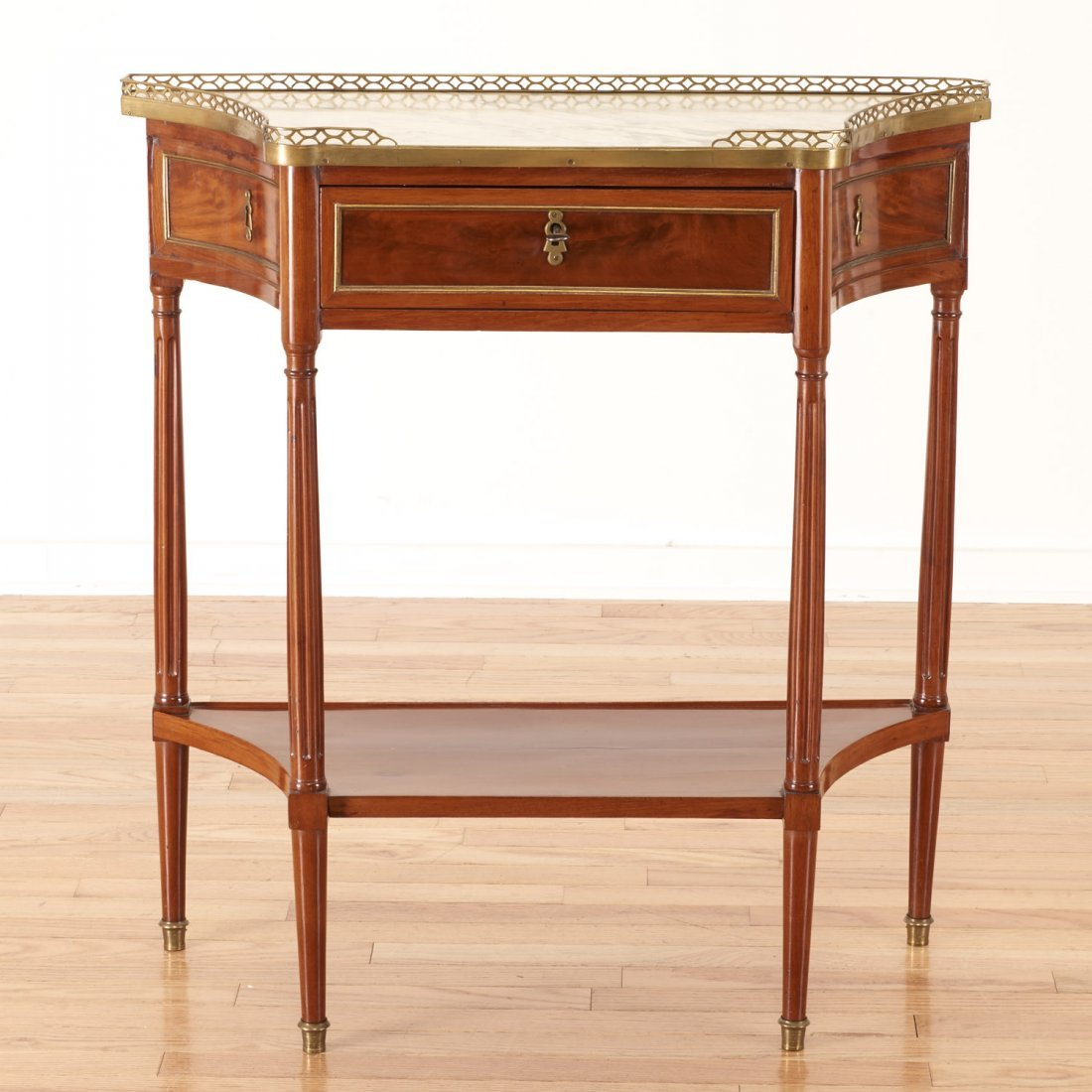 Louis XVI style brass mounted mahogany side table