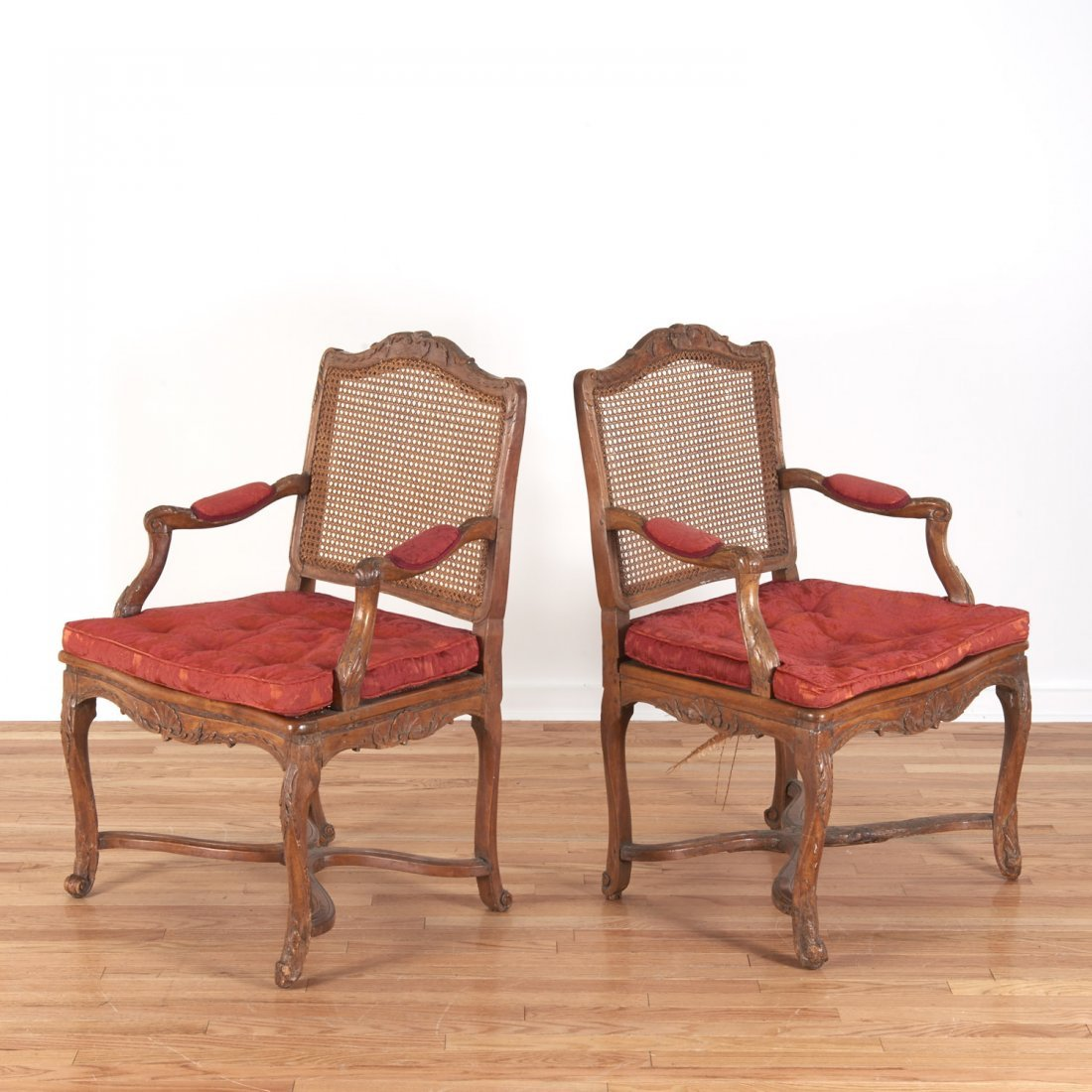 Pair Regence carved walnut open armchairs