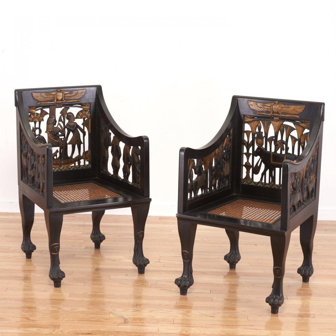 Pair Egyptian Revival gilt and ebonized armchairs